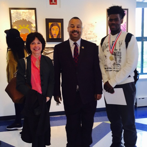 Congressmen Donald Payne, Jr. pictured with art contest winner and Arts High School student