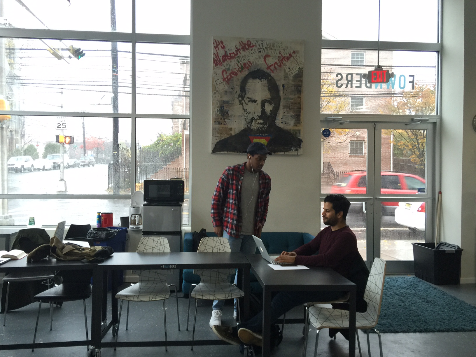 Fownders entrepreneurs chat under the watchful gaze of a Steve Jobs portrait. Photo: Andaiye Taylor (Click or tap to enlarge)